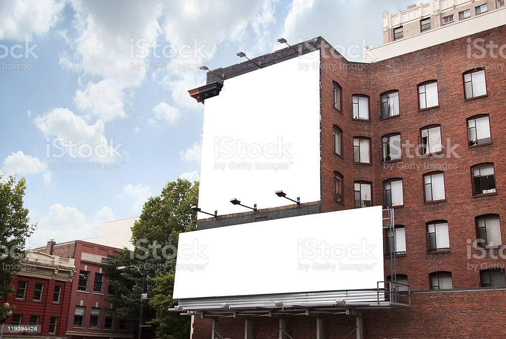 Two Billboards on Brick Building stock photo