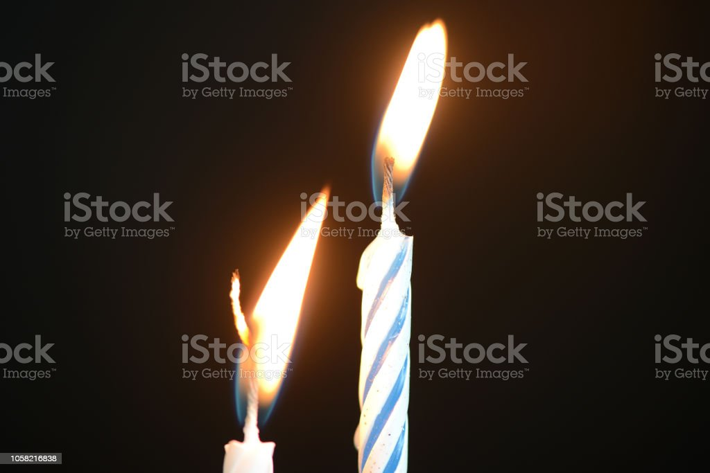 Two Birthday Candles Against A Dark Background Close Up Royalty Free Stock Photo Open Comp