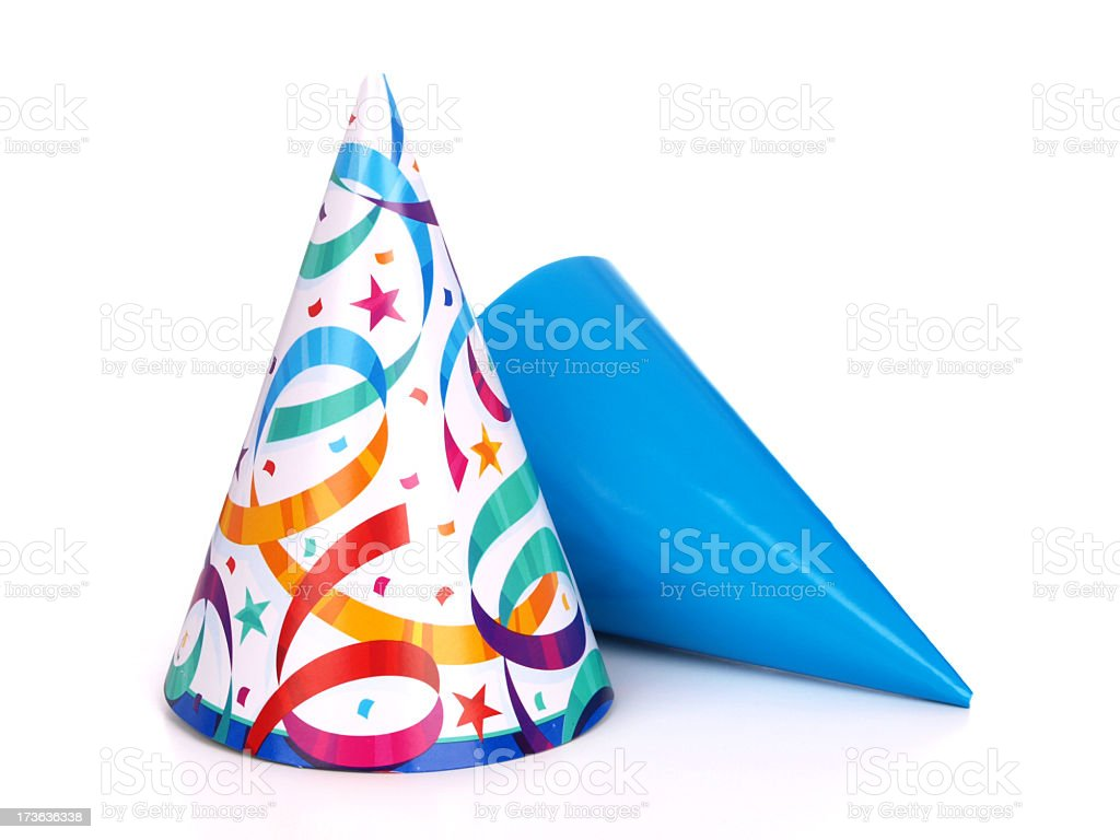 Two birthday party hats one blue and the other multicolored stock photo
