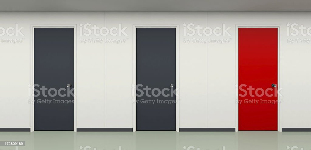 Two black and one red door in office corridor royalty-free stock photo