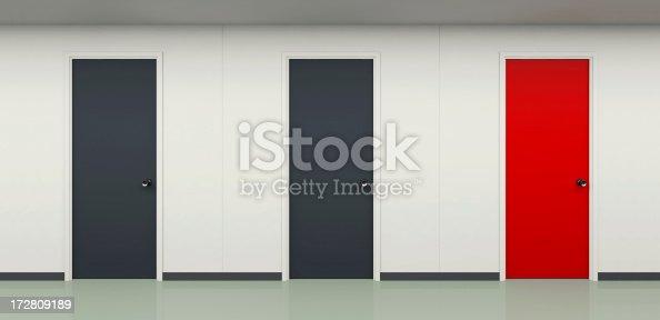 istock Two black and one red door in office corridor 172809189