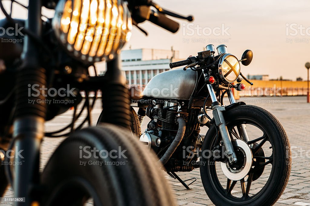Two black and silver vintage custom motorcycles caferacers stock photo