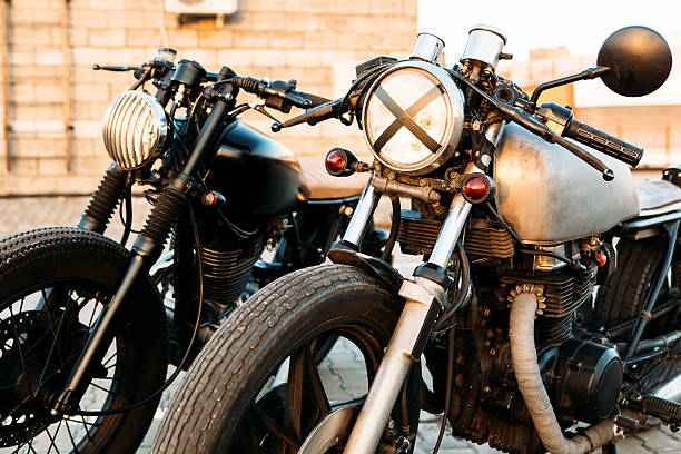 two black and silver vintage custom motorcycles caferacers - motorbike racing stock photos and pictures