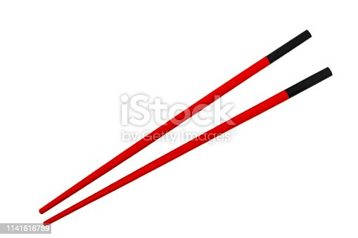 Two black chinese sticks with red holders isolated on white background