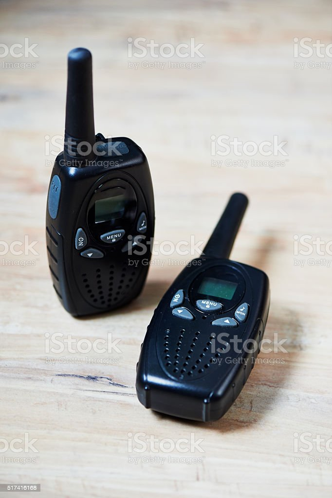 Two black professional portable radio sets with maps stock photo