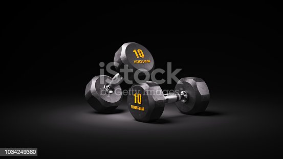istock Two black rubber dumbbells on dark 1034249360
