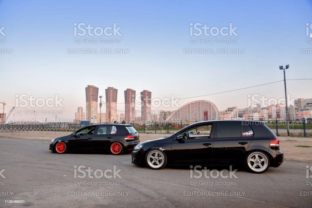 2 Black volkswagen golf tuning. Air suspension, orange wide wheels...