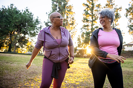 Two mature black woman together in nature.