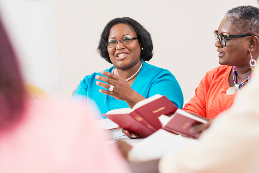 Two Black Women In Bible Study Group Stock Photo