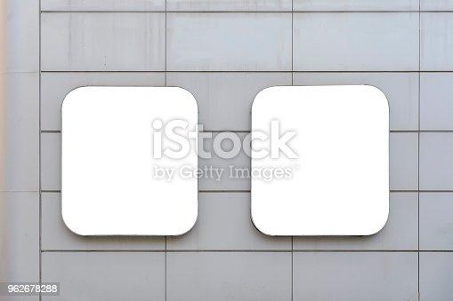 istock two blank billboard on a wall between lines. 962678288