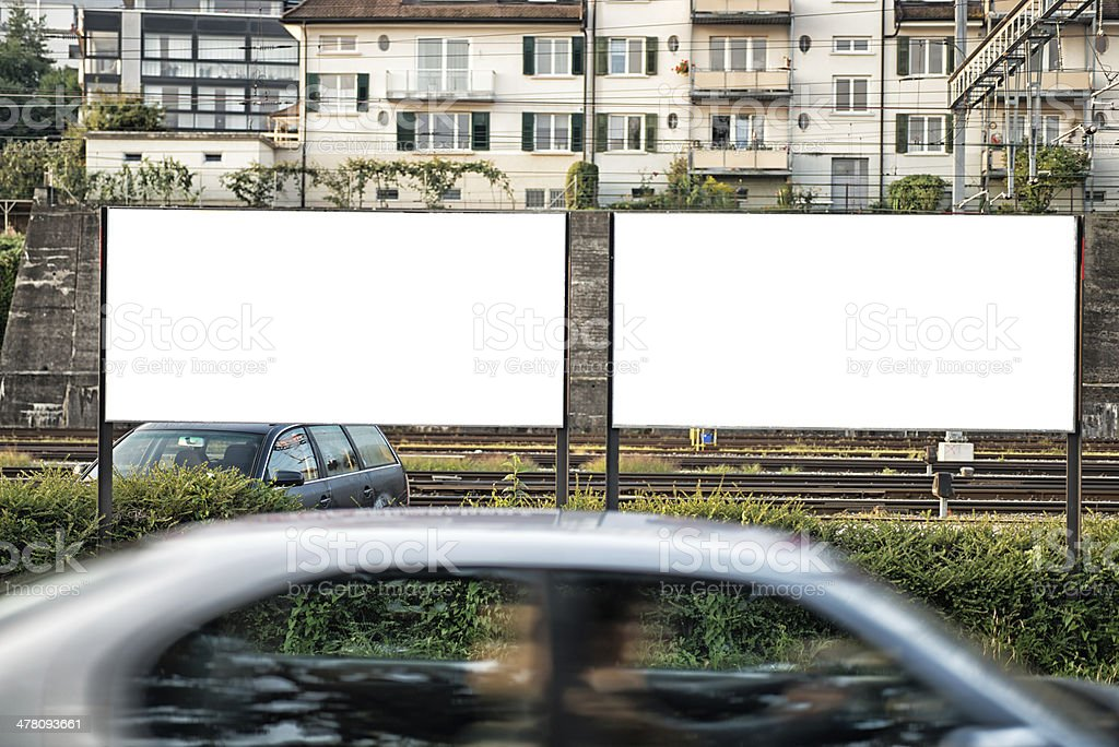 clipping path included. two blank billboard signs at roadside