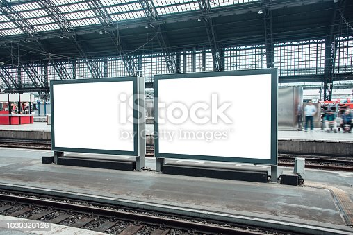 Two blank billboards at railroad station