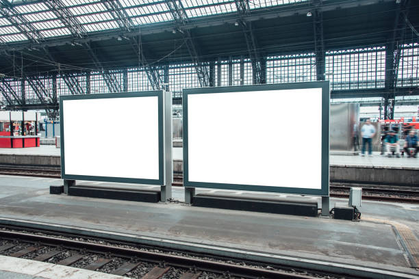 Two blank billboards at railroad station stock photo