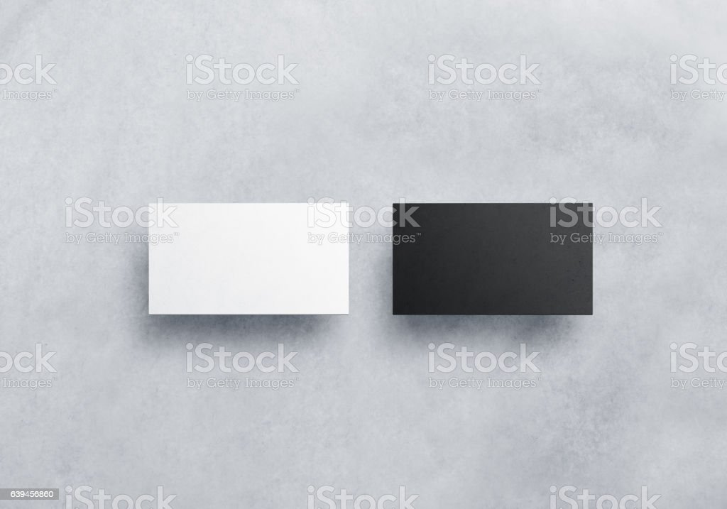 Two blank business card mockups isolated on grey textured stock photo