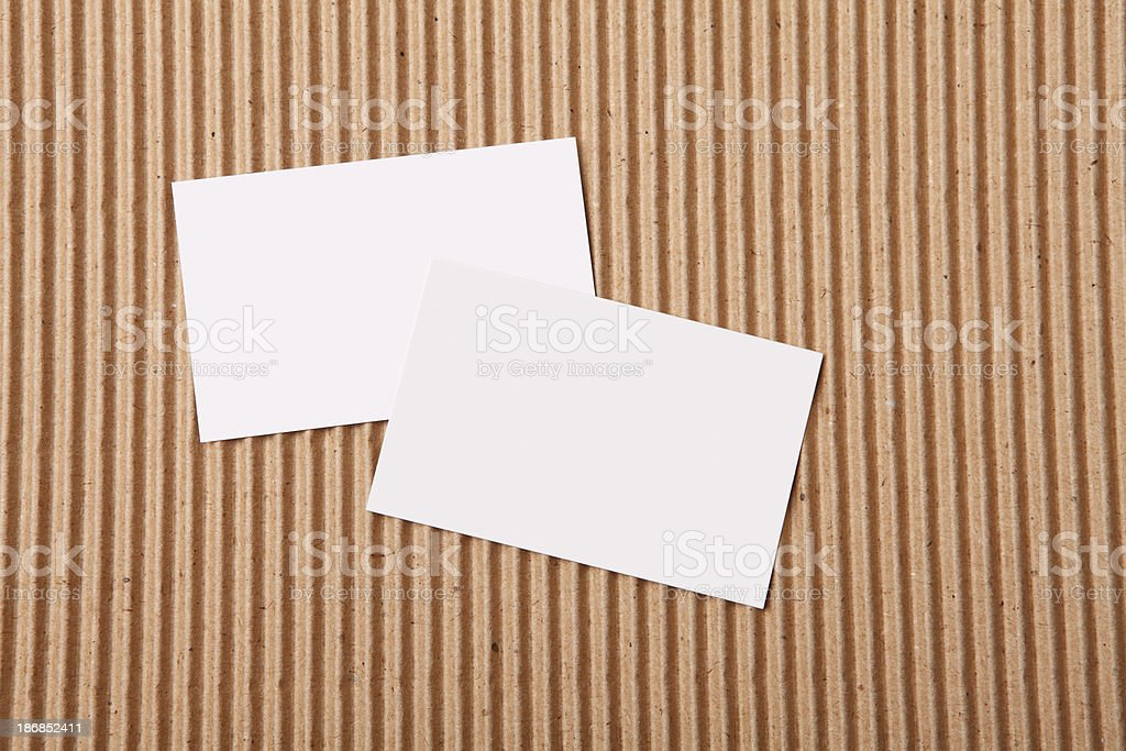 Two blank cards lie on brown abstract paper XXXL royalty-free stock photo
