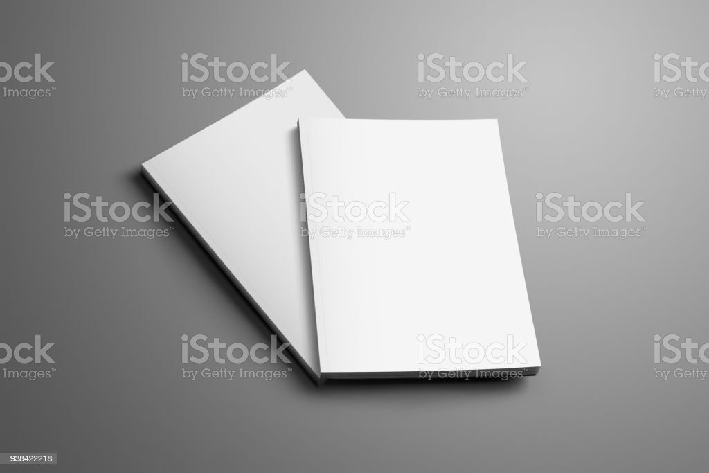 Two blank closed A4, (A5) brochures with soft realistic shadows isolated on gray background. stock photo