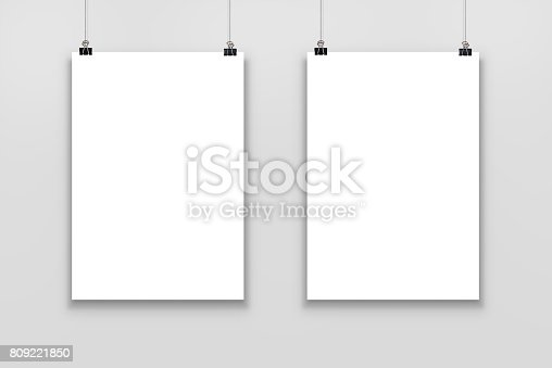 istock Two blank paper poster mockup isolated on a gray background. 809221850