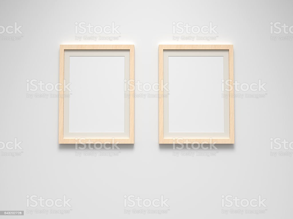 two blank picture frames on wall stock photo