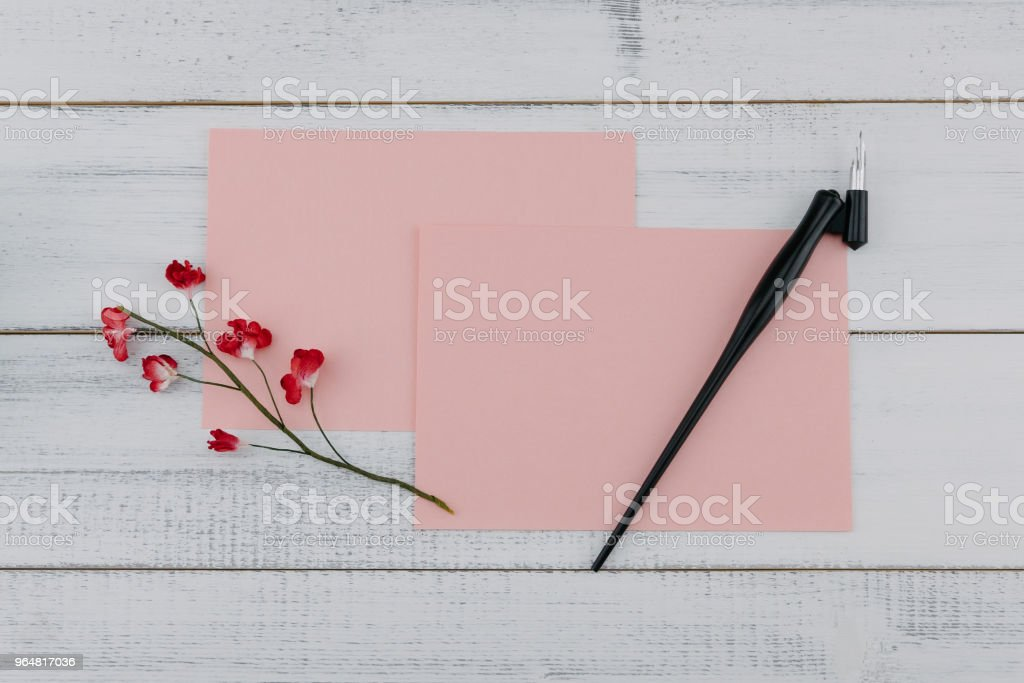 Two blank pink card and oblique pen royalty-free stock photo