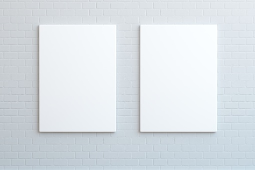 istock Two blank posters hanging on the wall, mock up 641715632