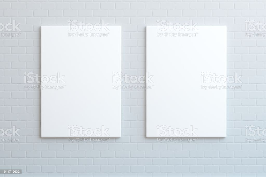 Two blank posters hanging on the wall, mock up stock photo