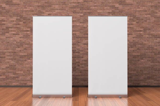 Two blank roll up banner stands stock photo
