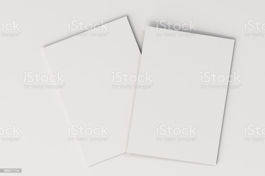 Two blank white closed brochure mock-up on white background stock photo