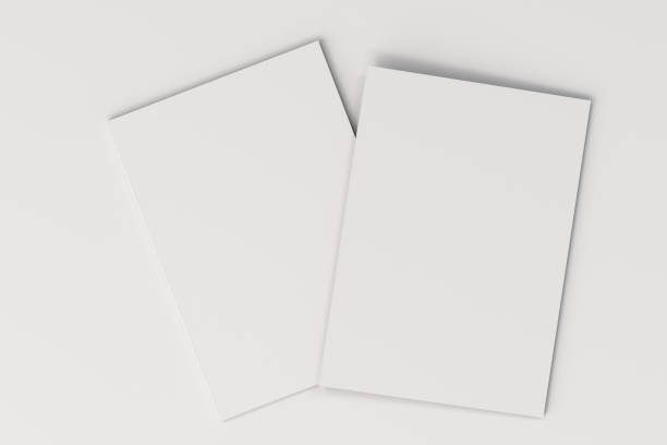 two blank white closed brochure mock-up on white background - magazine cover stock photos and pictures