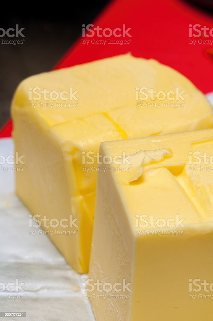 Two blocks of unwrapped butter royalty-free stock photo