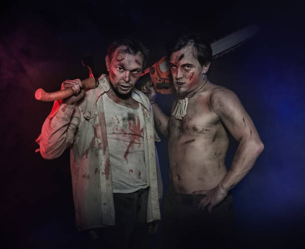 Two bloody and dirty vampire and monster hunters. Halloween scene Two bloody and dirty vampire and monster hunters in fog. Halloween scene mass murder stock pictures, royalty-free photos & images