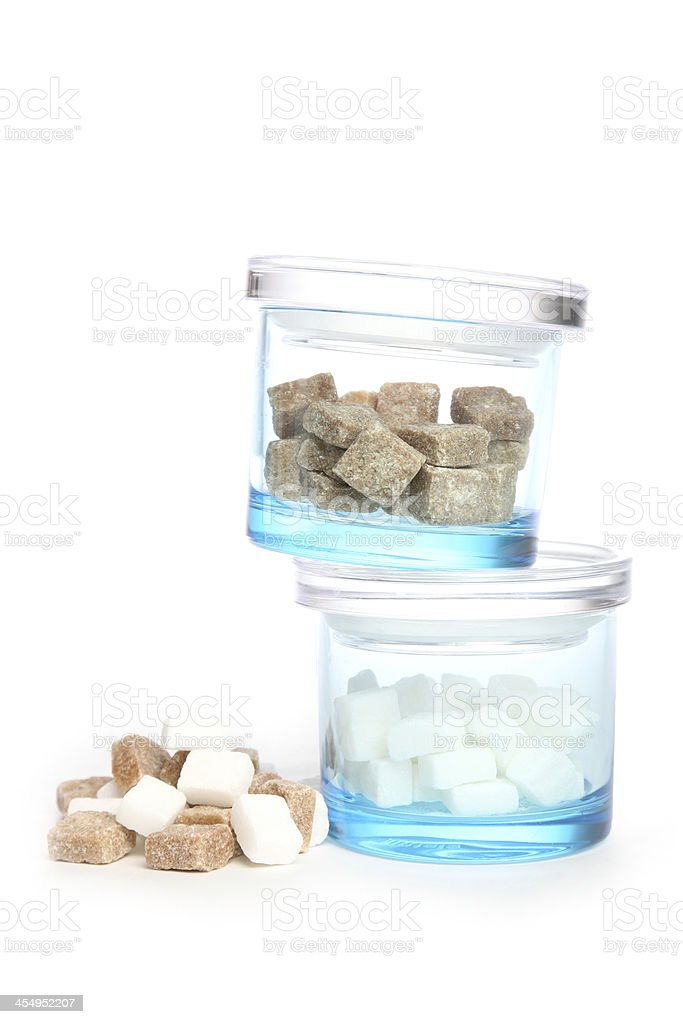 Two blue containers with brown and white sugar royalty-free stock photo