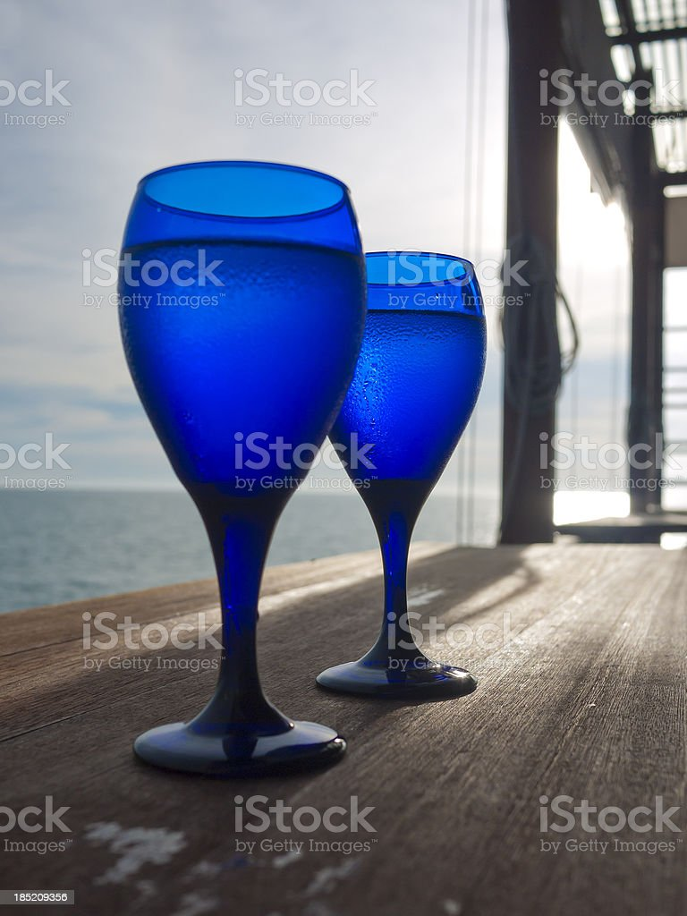 two blue glass of water stock photo