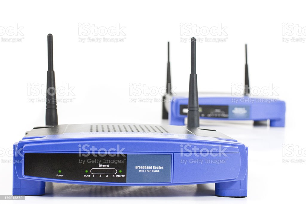two blue internet router with four antennas royalty-free stock photo