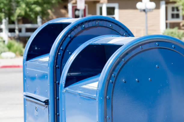 Two blue post office mail boxes