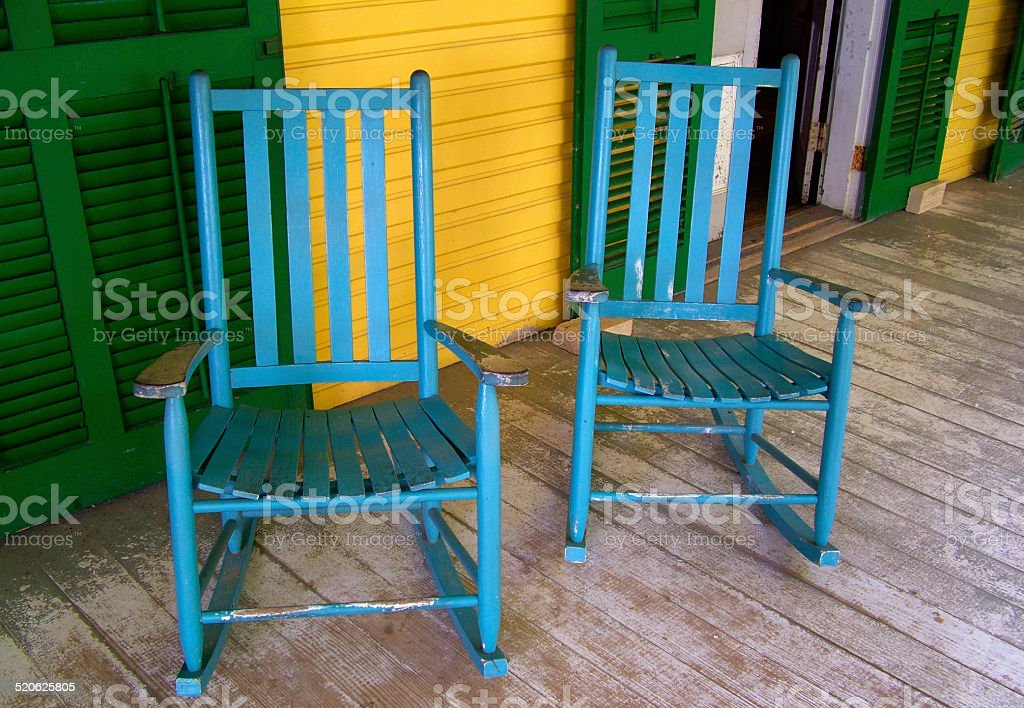 Two blue rocking chairs stock photo