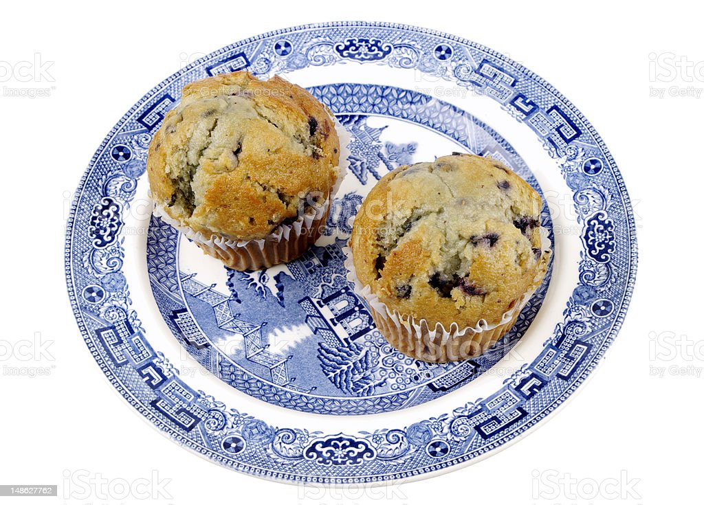 Two Blueberry Muffins On A Willow Pattern Plate Isolated royalty-free stock photo
