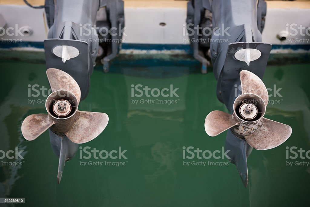 two boat engine with propeller details shot stock photo