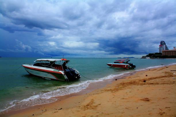 Two Boats Anchored at Pattaya Beach stock photo