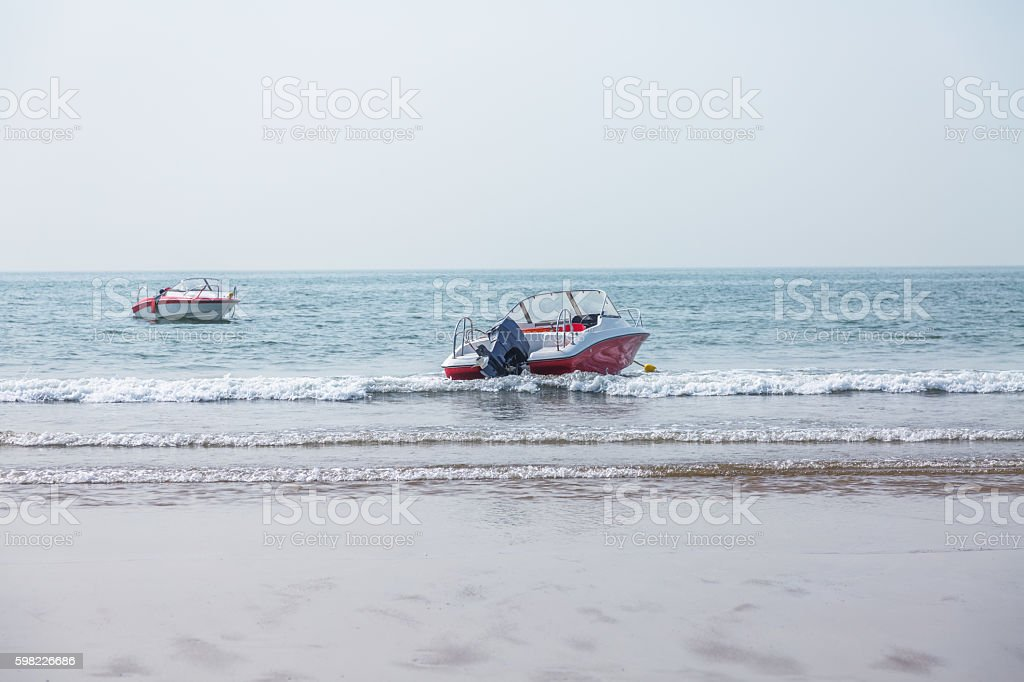 two boats floating at the beach foto royalty-free