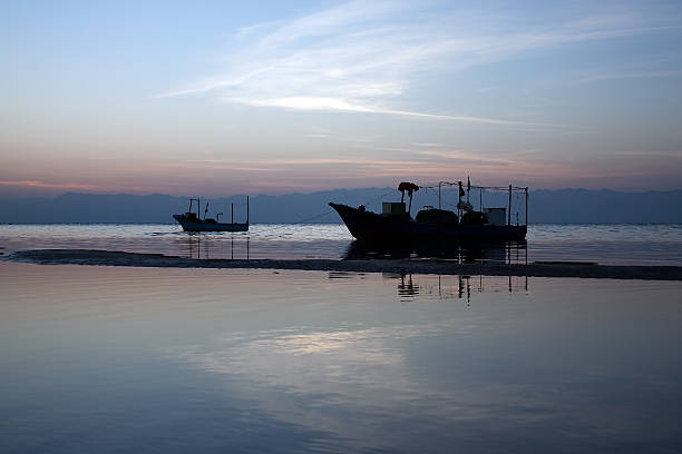 Two boats in Gulf of Aqaba During Morning Twilight stock photo
