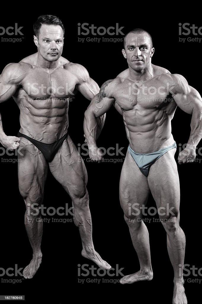 Two bodybuilders posing royalty-free stock photo