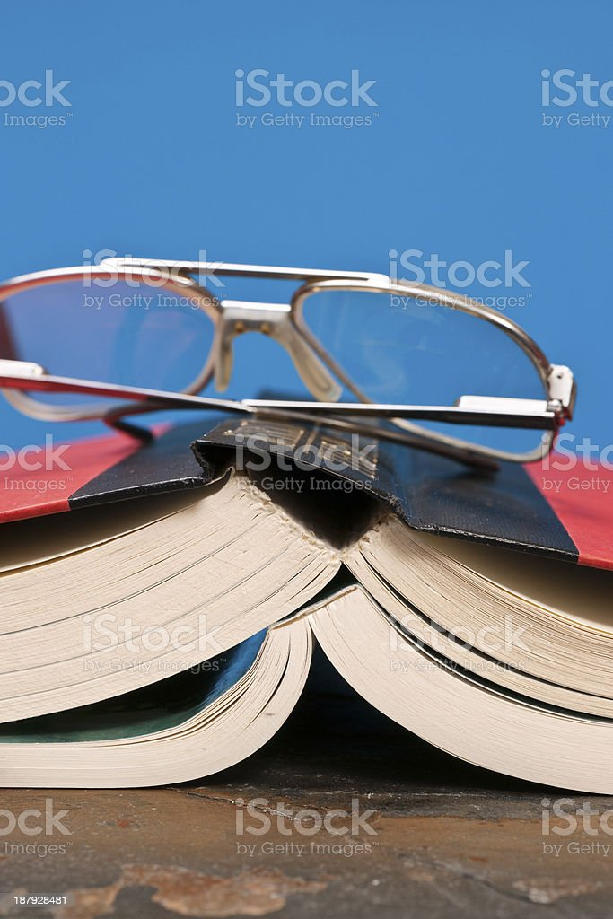 Two Books and Eye Glasses royalty-free stock photo