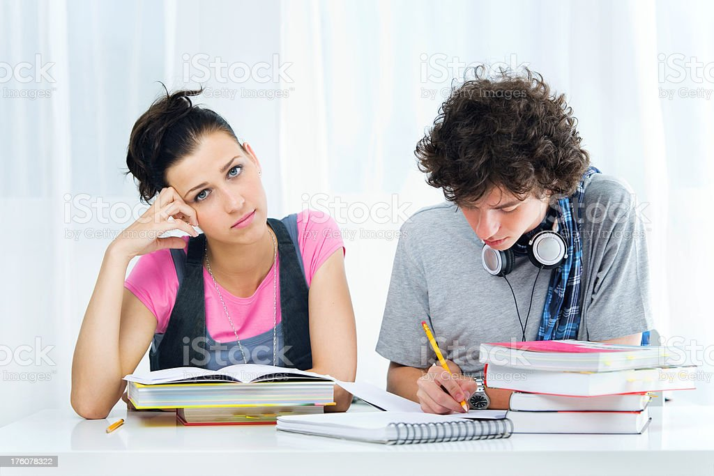 Two Bored Students Sitting Together royalty-free stock photo