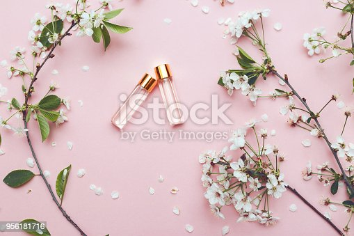 istock Two bottles of perfume with apricot blossom 956181716