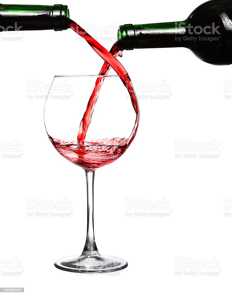 Two bottles of red wine and one glass stock photo