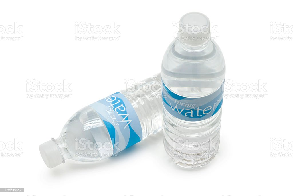 Two bottles of spring water against white background royalty-free stock photo