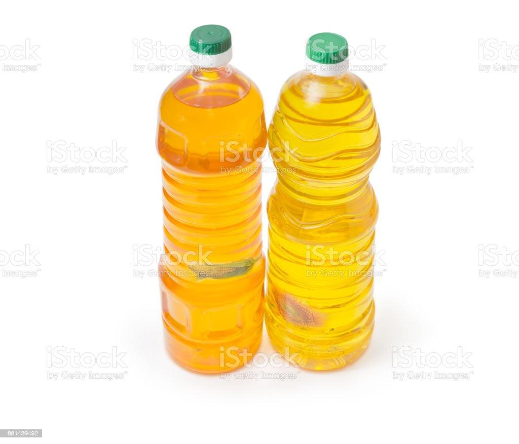 Two bottles of sunflower oil and corn oil stock photo