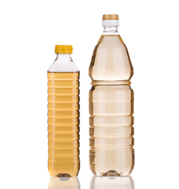 Two bottles of vinegar. Two bottles of vinegar. It is isolated in a white background. Close-up. vinegar stock pictures, royalty-free photos & images