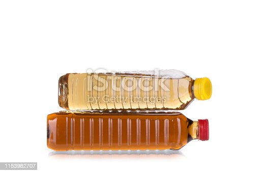 Two bottles of vinegar. Isolated in a white background. Close-up.