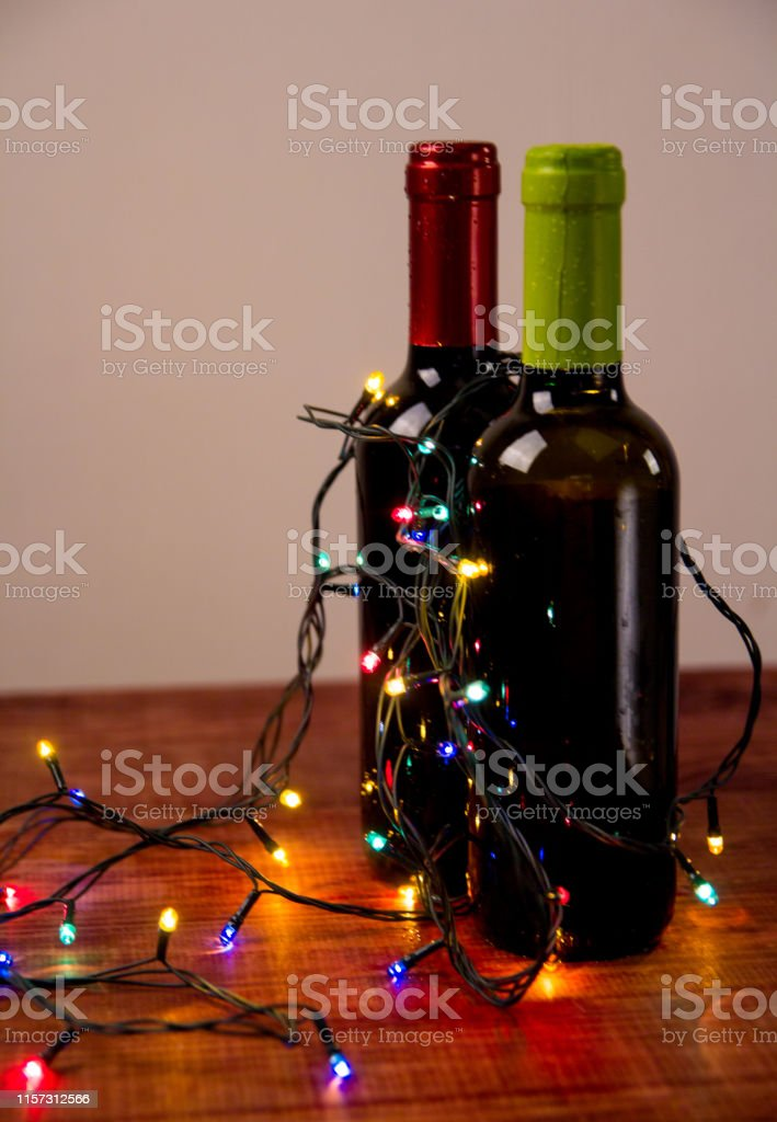 Two bottles of wine with garlands, concept, holiday, Christmas, style...